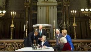 President Barack Obama & Swedish Prime Minister Fredrik Reinfeld (center standing) Nina Lagergren, 92, (center seated half-sister of Raoul) view his personal possessions_Sept. 4, 2013